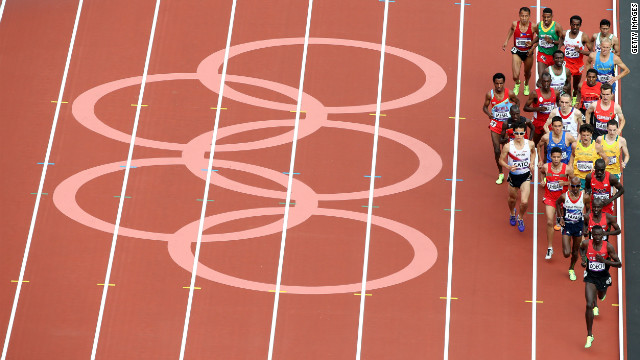 Athletes compete in round one of the men's 5,000-meter heats at Olympic Stadium. Check out <a href='http://www.cnn.com/2012/08/09/worldsport/gallery/olympics-day-thirteen/index.html' target='_blank'>Day 13 of the competition</a> from Thursday, August 9.