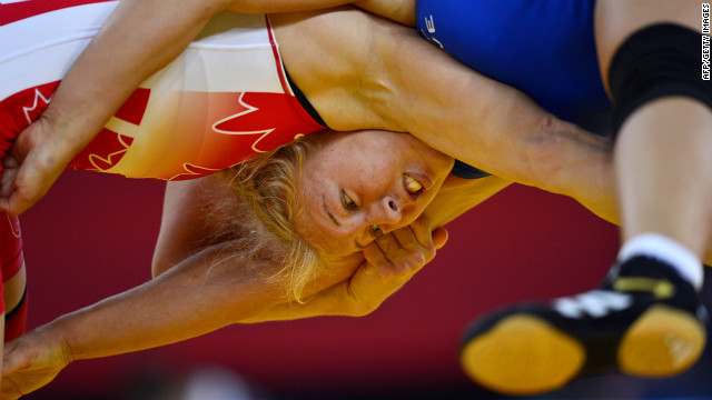 Canada's Martine Dugrenier, right, wrestles Sweden's Henna Johansson in their women's 63 kilogram freestyle repechage round 2 match.
