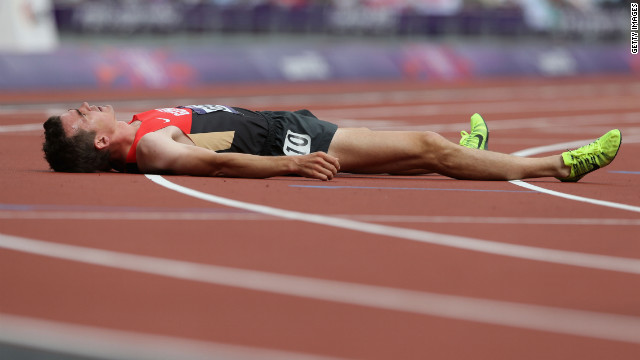 Germany's Arne Gabius rests after round one of the men's 5,000-meter heats.