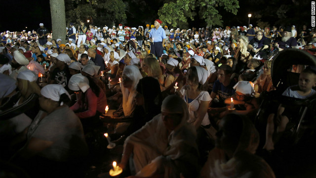Mourners and supporters of the Sikh Temple of Wisconsin attend the vigil at the Oak Creek Community Center on Tuesday night.