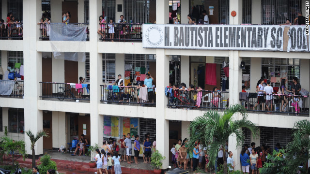 Residents of Marikina City in suburban Manila fill a school building serving as a flood evacuation center on Thursday.