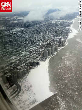"Marvin Mason took this ""apocalyptic"" shot of Chicago flying over Lake Michigan. ""The icy waters added to the drama."""