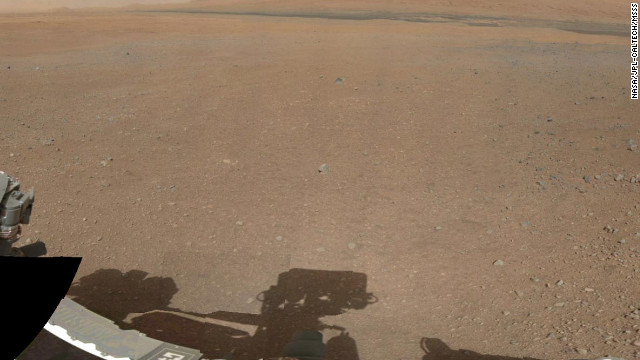 A partial view of a 360-degree color panorama of the Curiosity rover's landing site on Gale Crater. The panorama comes from low-resolution versions of images taken Thursday, August 9, with a 34-millimeter mast camera. Cameras mounted on Curiosity's remote sensing mast have beamed back fresh images of the site.