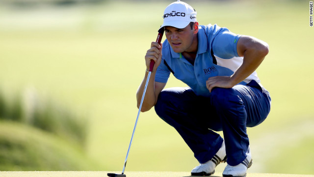 Martin Kaymer of Germany lines up a putt on the 11th green.