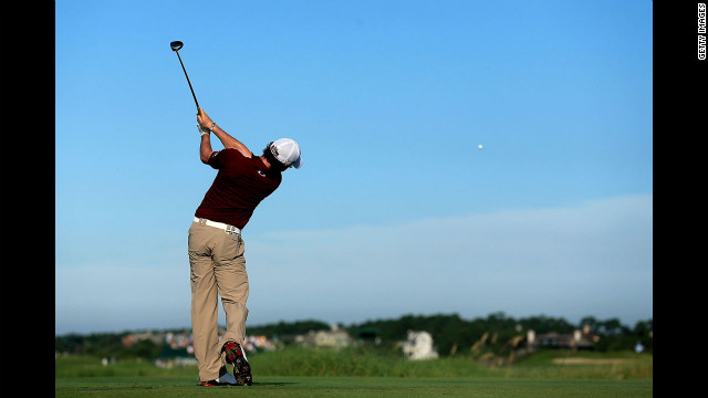Rory McIlroy of Northern Ireland hits off the 12th tee.