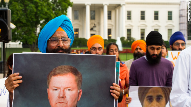 Sikhs gather at Washington's Lafayette Park, across from the White House, for a Night of Remembrance of the Wisconsin Gurdwara Shootings on Wednesday, August 8. The man on the left is holding a poster of Oak Creek Police Officer Lt. Brian Murphy, who was shot multiple times as he pursued the gunman.