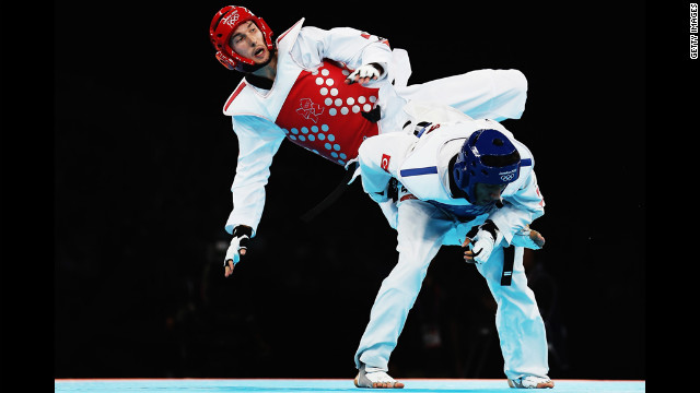 Martin Stamper of Great Britain competes against Servet Tazegul of Turkey during the men's 68-kilogram taekwondo semifinal match.