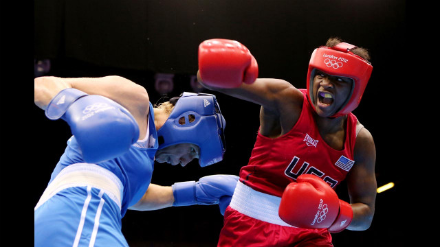 Claressa Shields, in red, battles Nadezda Torlopova of Russia during the women's middleweight boxing final. Shields defeated Torlopova 19-12 to take the gold, becoming the first U.S. woman to take an Olympic boxing gold. <a href='http://cnnphotos.blogs.cnn.com/2012/07/20/t-rex-the-youngest-female-olympic-boxer/' target='_blank'>See more photos of Shields and read her story on CNN's photo blog</a>.