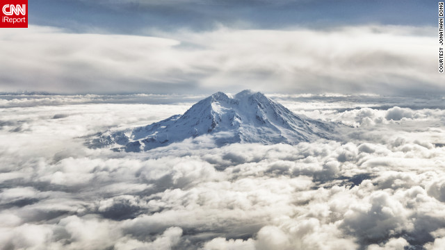 "Jonathan Dong, a student and freelance photographer, created a panoramic photo (cropped here) of Washington's Mount Rainier by laying five images horizontally. ""It was the only peak in view that was capable of rising up to bathe in the morning sun, shining in the light, but yet completely solitary."""