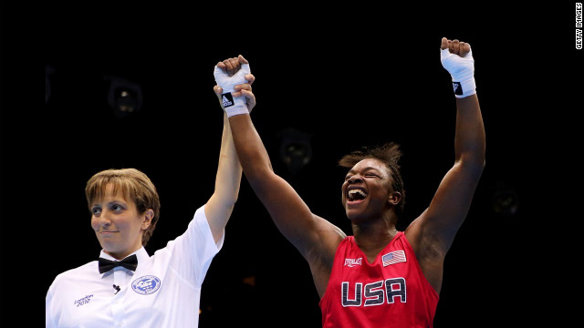 Shields celebrates her victory as the referee announces her win.