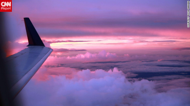 "Nervous flier Rosa Mangin took this gorgeous sunset shot during a flight from Memphis, Tennessee, to Tupelo, Mississippi. ""Staring at the beauty of the clouds that night, I could not help but think how much of life I would miss out on if I let my fear of flying overcome me."""