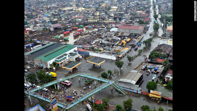 A Department of National Defense aerial photograph shows floodwaters in Navotas city, north of Manila, on Wednesday, August 8.