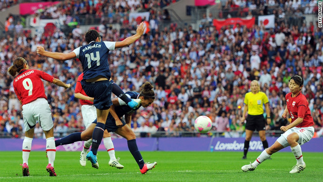 Carli Lloyd heads in a goal.