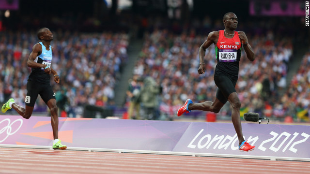 David Lekuta Rudisha of Kenya approaches the finish line ahead of Nijel Amos of Botswana to win gold and set a world record in the men's 800-meter final.