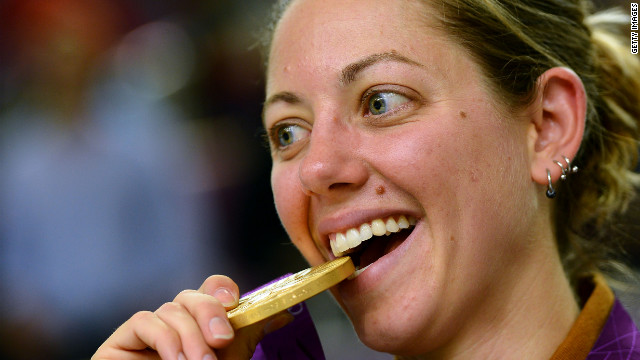 Jamie Lynn Gray of the U.S. bites her gold medal after winning the women's 50-meter rifle three positions shooting finals.