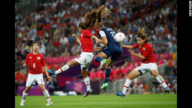 Forward Alex Morgan of the United States battles for the ball during Thursday's match against Japan.