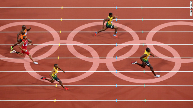 Usain Bolt of Jamaica leads Yohan Blake of Jamaica during the men's 200-meter final.