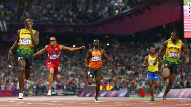 Usain Bolt of Jamaica celebrates as he crosses the finish line ahead of Wallace Spearmon of the United States, Churandy Martina of Netherlands, Yohan Blake of Jamaica and Alex Quinonez of Ecuador to win gold in the men's 200-meter final.