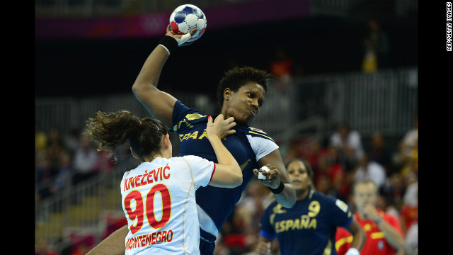 Spain's leftback Nely Alberto Francisca vies with a competitor during the women's semifinal handball match between Spain and Montenegro.