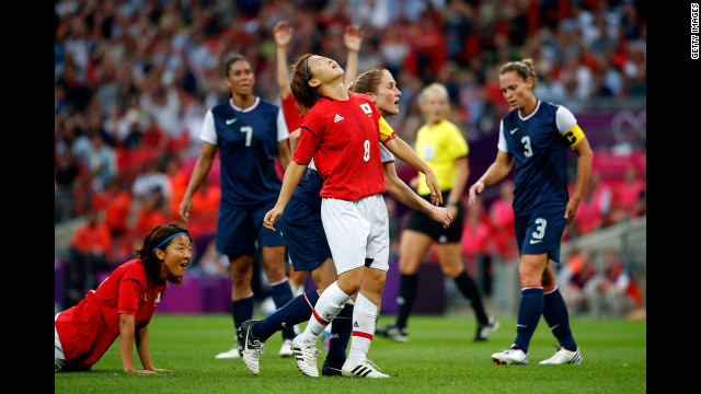 No. 8 Aya Miyama of Japan reacts after hitting the cross bar on a shot in the first half against the United States during the women's football gold medal match.