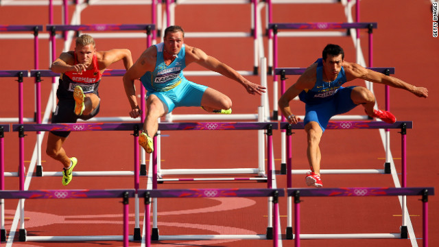 From left, Pascal Behrenbruch of Germany, Dmitriy Karpov of Kazakhstan and Oleksiy Kasyanov of Ukraine race during the men's decathlon 110-meter hurdles heats.