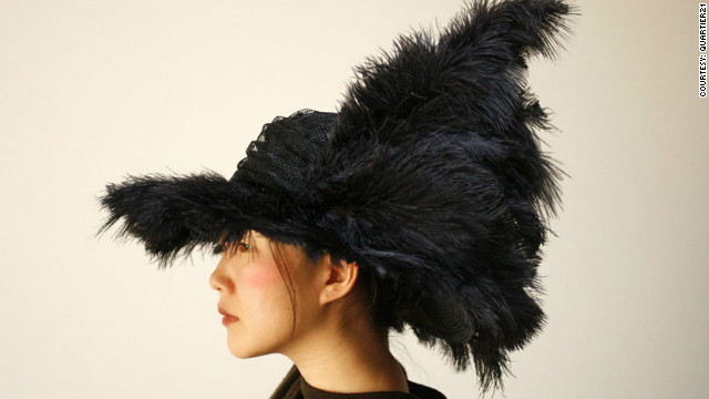 &quot;Taiknam Hat&quot; is designed to respond to changes in surrounding radio signals. A detection system measures medium-wave radio signals and passes on the information to a microcomputer. The computer then activates motors that move the feathers adorning the hat. &quot;Our intention is to ... contribute to our awareness of the increasing level of electromagnetic radiation in our environment,&quot; say its designers.