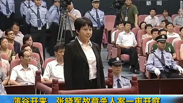 Image from CCTV video shows Gu Kailai (C) facing the court during her murder trial in Hefei on August 9, 2012.