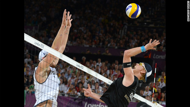 Germany's right blocker Jonas Reckermann, right, jumps in front of Brazil's left blocker Alison Cerutti, left, during the men's beach volleyball final match on Thursday, August 9, in London. <a href='http://www.cnn.com/2012/08/08/worldsport/gallery/olympics-day-twelve/index.html'>Check out Day 12 of competition</a> from Wednesday, August 8. The Games ran through Sunday.