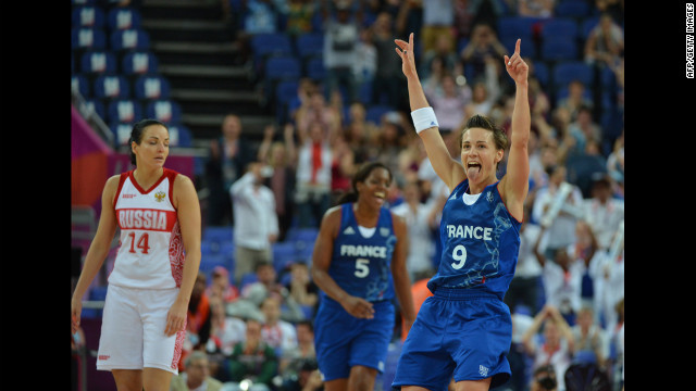 French guard Celine Dumerc celebrates after winning 81-64 against Russia during the women's semifinal basketball game between Russia and France.