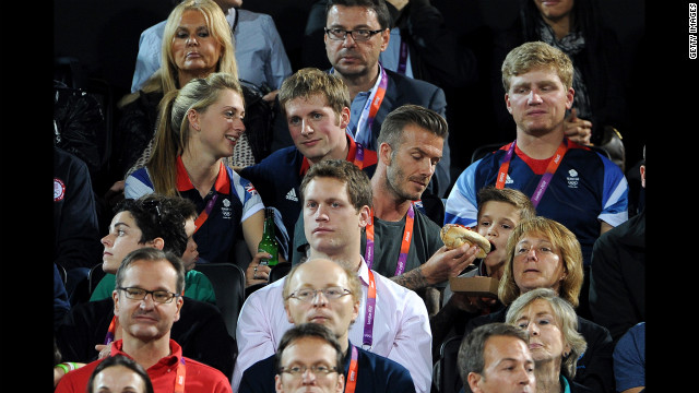 From left, British cyclists Laura Trott and Jason Kenny and David and Romeo Beckham watch the beach volleyball.