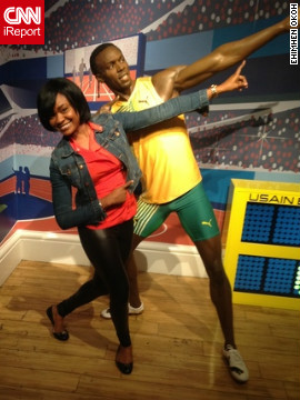 Ehimhen Okoh is on vacation in London and had her boyfriend shoot this picture of her at Madame Tussauds wax museum in front of Usain Bolt's new statue<!-- -->.</br>