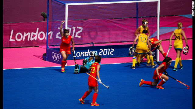 China's Qingling Song, left, celebrates a disallowed goal in the women's field hockey classification match against Australia.