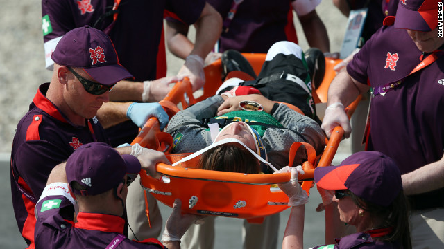 Brazi's Squel Stein is carried off in a stretcher after crashing in the women's BMX cycling semifinals.