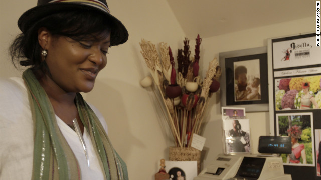 "Jan Asante in her boutique ""Gisella's,"" in south London, which she runs with her mother Gisella Asante."