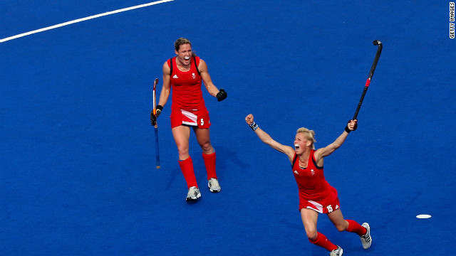 Alex Danson, right, and Crista Cullen of Great Britain react during their women's hockey bronze medal match against New Zealand.