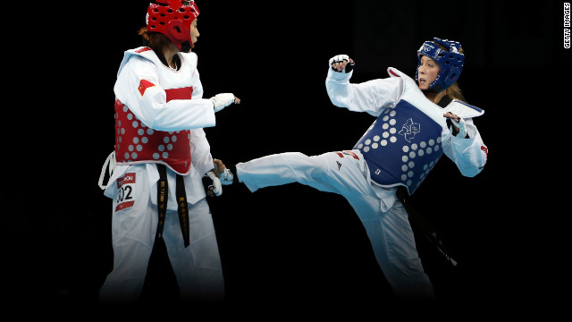 Jade Jones of Great Britain competes against Yuzhuo Hou of China during the women's 57kg Taekwondo gold medal final. Jones ended up winning the bout making the Welsh taekwondo medalist the first British taekwondo champion ever. 