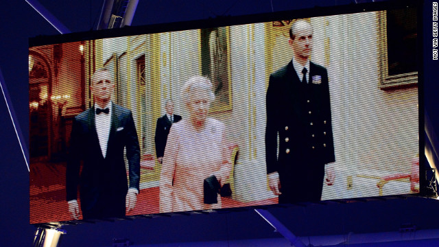 Queen Elizabeth II appears on screen accompanied by actor Daniel Craig during the opening of the 2012 Summer Olympics.