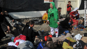 The world\'s attention was caught by the pain of the girl in the green dress. Behind her in a yellow dress is Fatima and lying in the pile of victims is Gulmina.