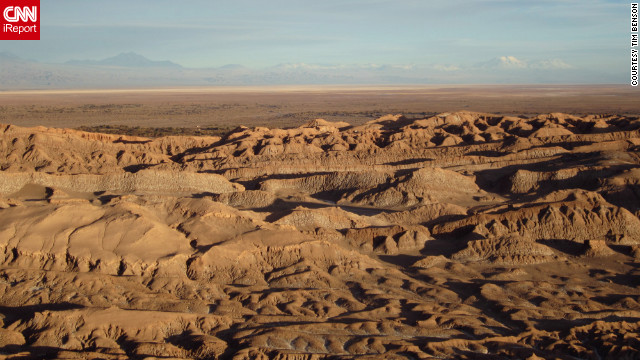 "The view of Chile's Atacama Desert at sunset reminded <a href='http://ireport.cnn.com/docs/DOC-825759 '>Tim Benson</a> of Mars, ""with the red coloring of the stone and the vast isolation and absence of life. Very moving, very serene, it felt as though we had departed the world."""
