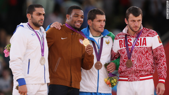 From left to right: Silver medalist Sadegh Saeed Goudarzi of Iran, gold medalist Jordan Ernest Burroughs of the U.S. and bronze medalists Soslan Tigiev of Uzbekistan and Denis Tsargush of Russia on the podium of the men's 74-kilogram freestyle.