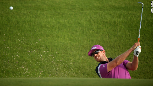Hunter Mahan hits out of the sand on the 10th hole.