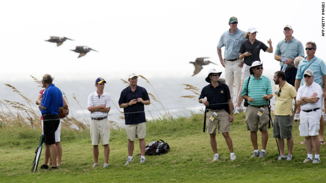 Golf fans watch during the second round of the championship.