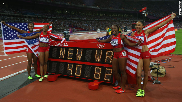 Carmelita Jeter, Bianca Knight, Allyson Felix and Tianna Madison of the United States celebrate next to the clock after winning gold and setting a new world record of 40.82 seconds in the women's 4x100m relay final.
