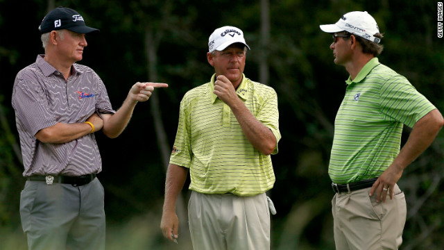England's Roger Chapman, from left, Mark Brooks of the United States and South Africa's Retief Goosen talk on the 2nd tee.