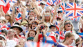 Fans of the home side, Team GB, wave Union Jack flags during the Olympic Games