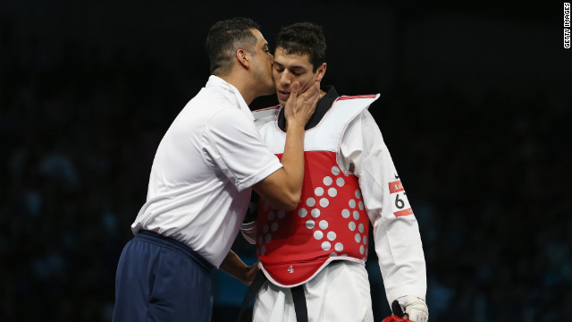 American Steven Lopez walks off after losing to Ramin Azizov of Azerbaijan in the taekwondo bout.