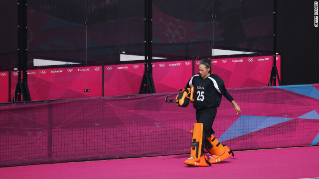 U.S. goalkeeper Amy Swensen walks off the pitch after being substituted for an offensive player in the last minutes of the women's field hockey classification match between the United States and Belgium. Check out<a href='http://www.cnn.com/2012/08/11/worldsport/gallery/olympics-day-fifteen/index.html' target='_blank'> Day 15 of the competition </a>from Saturday, August 11.