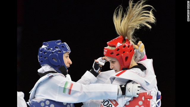 Iran's Sousan Hajipourgoli, left, battles Australia's Carmen Marton in women's taekwondo in the under 67-kilogram division.