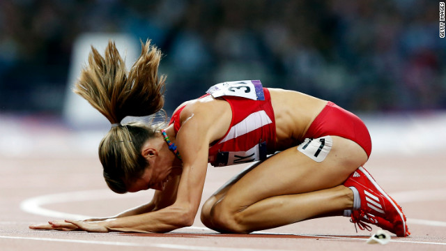 Morgan Uceny of the United States reacts after falling during the women's 1500-meter final.