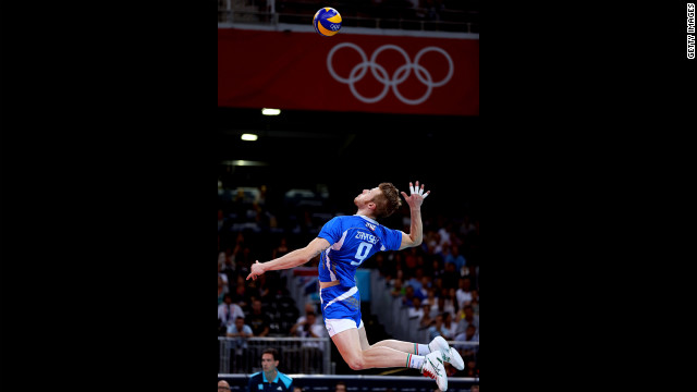 Ivan Zaytsev, No.9 of Italy, serves the ball against Brazil during the men's volleyball semifinals.